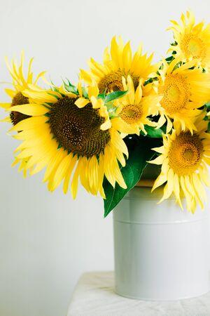 bouquet of bright yellow sunflower flowers in a retro vase Banco de Imagens