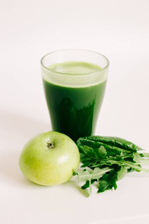 green freshly squeezed juice from green Apple and young beet leaves