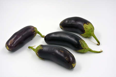 Fresh and healthy vegetables from breast, blue, purple eggplants located on a white background. Stockfoto