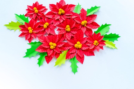 Paper flower poinsettia and leaves of holly christmas wreath paper flower poinsettia and leaves of holly christmas wreath white background colors are mightylinksfo