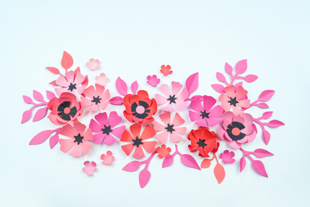 Flower and leaf of pink and black color made of paper. Handwork, favorite hobby. White background.