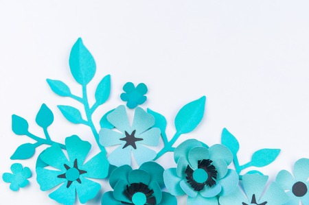 Flower and leaf of blue color made of paper. Handwork, favorite hobby. White background.