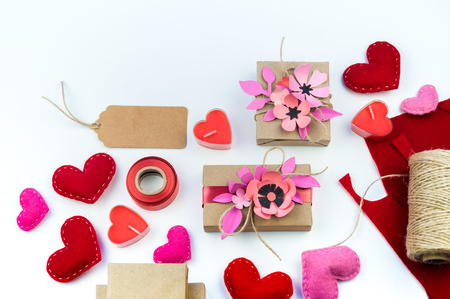 Gift wrapping for Valentines day. Tools and decor for the holiday. Flower paper hack. Romantic setting. A gift with love.