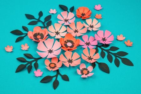 Flower and leaves made of paper on a turquoise background handwork banque dimages flower and leaves made of paper on a turquoise background handwork favorite hobby pink black and blue color mightylinksfo