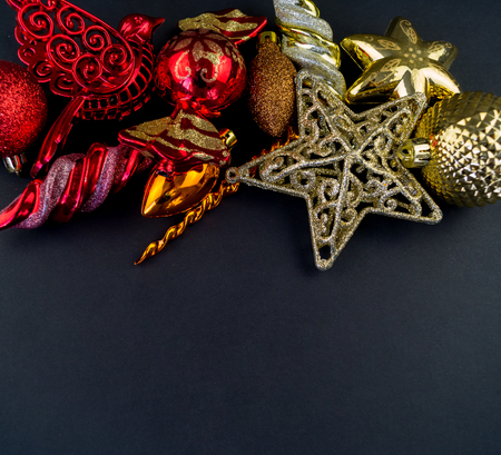 Colorful christmas baubles in red and gold. Brilliant toys for decorating the Christmas tree.