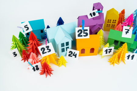 Advent calendar for baby rainbow color. House and Christmas tree paper craft. Christmas holiday decor. White background. Numbers on the label.