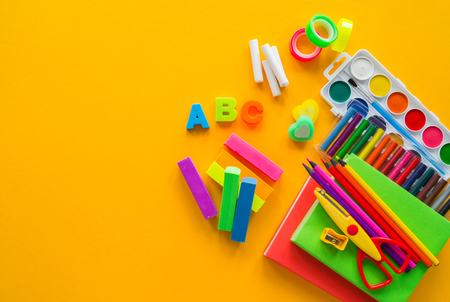 Stationery yellow background. Education. Training material for learning and creativity. Bookstore advertising. School and kindergarten.