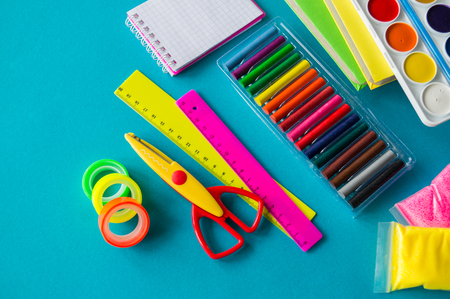 Stationery for study at school lies on blue. Imagens