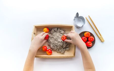 Montessori apples. Sorting shapes. Kinetic sand. Wooden tray with material. Tongs and tool. Stock fotó