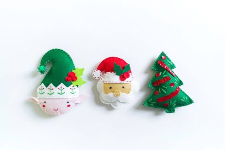 Toy made of felt to decorate the Christmas tree. New Year home decor. Gift stuff. Creativity for children kindergarten.