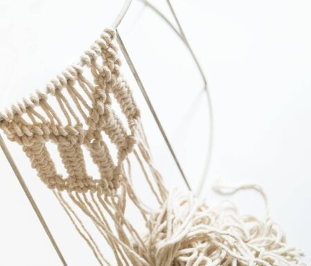 Weaving macrame. Favorite hobby. Threads natural material and color. Eco style.