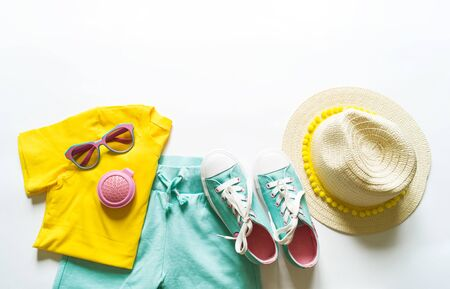 Clothes summer white background. Fashion style. Children's clothes bright colors.