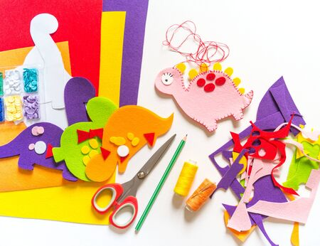 Craft from felt instruction for creating a dinosaur toy. Material for creativity.Favorite cozy hobby