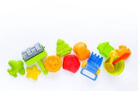 Toys for sand. Children's toy summer sea game. Multicolored plastic mold. White background. Flat lay. Rainbow color. Kindergarten playground on outdoor Stock fotó