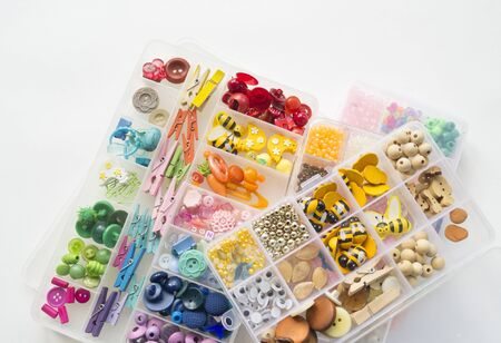 Beads in a box. Sort material. Favorite hobby weaving bracelets.