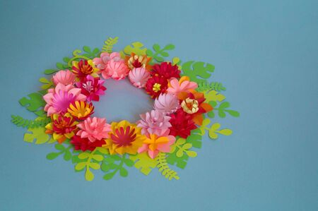 Flowers made of paper. Blue background. Creativity Spring Festival