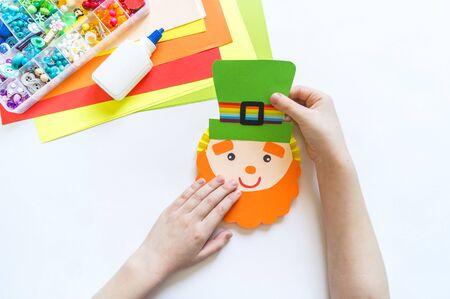 Leprechaun paper craft. St.Patrick 's Day. Four leaf clover green. Material for creativity. Children's creativity