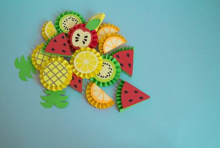 Fruit made of paper. Children's hobby. Summer style tropics.