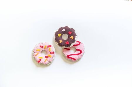 Donuts made of felt. Craft for children. A toy for a child. Material for creativity Standard-Bild