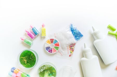 DIY slime. Ingredients and decorations for slimes. Jars of sequins and beads