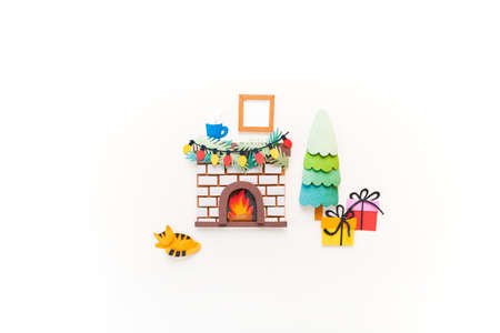 Christmas fireplace. Diy craft paper art. Holiday new year family concept. White background. Copy space