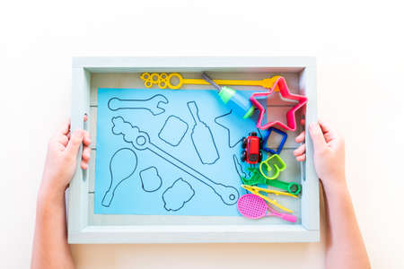 Montessori material sorting shape. Education at home. Lesson with children. White background.