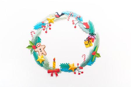 Paper art Christmas concept. Craft diy holiday. Wreath on the door. Copy space Reklamní fotografie