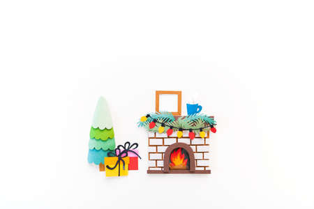 Christmas fireplace. Diy craft paper art. Holiday new year family concept. White background. Copy space Reklamní fotografie - 162991416