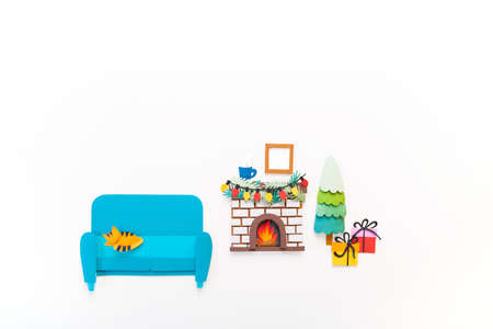 Christmas fireplace paper craft concept. Art diy. Cozy home atmosphere on the eve of the holiday. White background 版權商用圖片