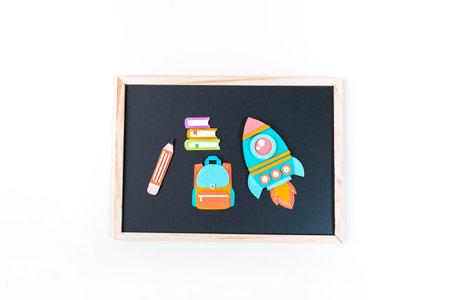 Rocket paper craft. Back to school education. Business startup concept. Paper creativity Black chalkboard background