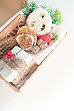 Christmas present in box. Eco friendly set. Zero Waste Ney Year Space for your greetings. Copy space Vertical