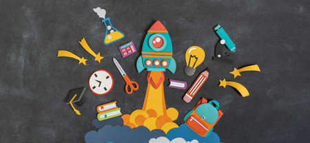 Rocket takes off paper craft. Back to school. Copy space. Black background school board. Education concept Banner Copy space