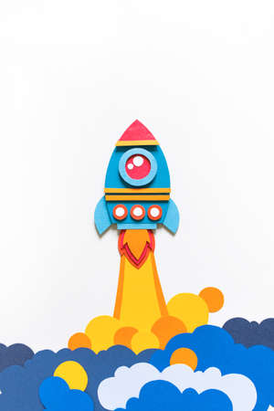 Rocket takes off paper craft. Back to school. Copy space. White background. Business concept 版權商用圖片