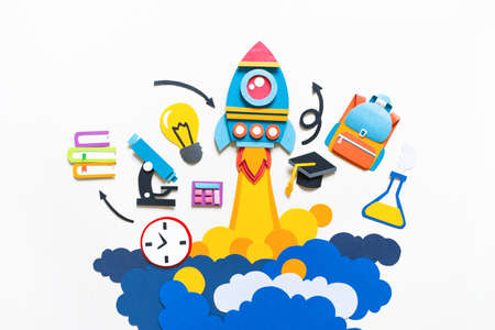 Rocket takes off paper craft. Back to school. Copy space. White background. Education concept