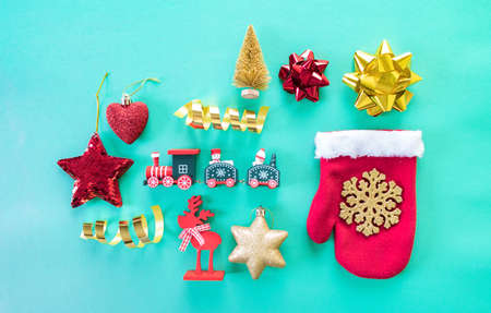 Christmas tree toys fall out of the mitten. Blue background. Color gold trend. Reklamní fotografie