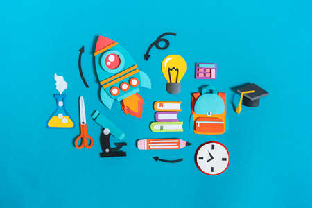 Student stationery items set paper craft. Back to school. Copy space. Blue background. Business concept