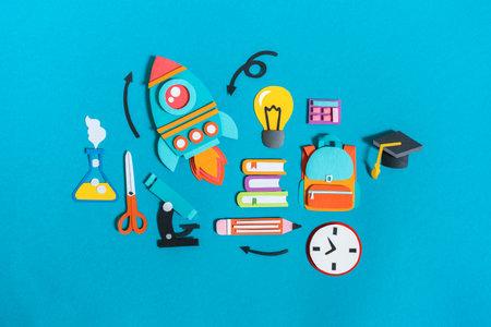 Student stationery items set paper craft. Back to school. Copy space. Blue background. Business concept Reklamní fotografie - 162163797
