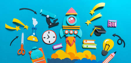 Rocket takes off paper craft. Back to school. Copy space. Blue background. Education concept banner