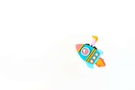 Rocket craft paper. Business startup concept. Man flies White background Copy space