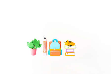Paper craft backpack. Back to school education. Business startup concept. Paper creativity diy White background
