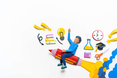 African American student flying on a pencil Paper crafrt. Education concept. White background. Schoolboy stationery items set. Reklamní fotografie