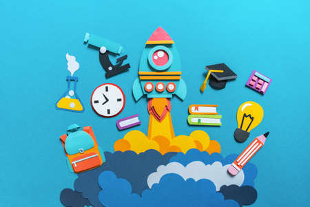 Rocket takes off paper craft. Back to school. Copy space. Blue background. Education concept 版權商用圖片