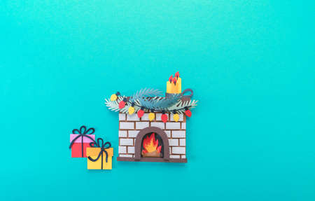 Christmas fireplace. Diy craft paper art. Holiday new year family concept. Blue background. Copy space