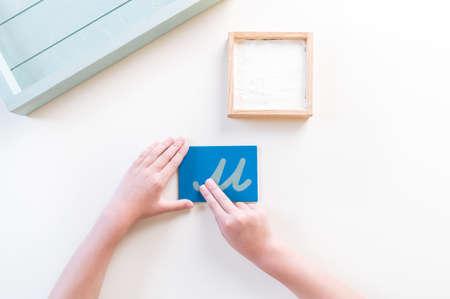Montessori material letter on white
