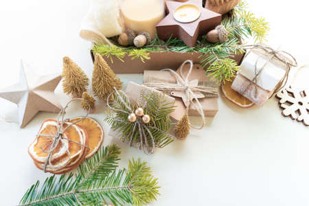 Christmas present in box. Eco friendly set. Zero Waste Ney Year Space for your greetings. Copy space Reklamní fotografie