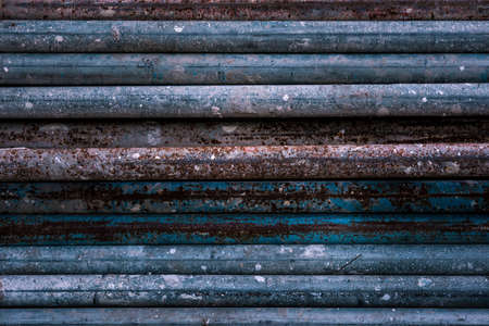 Stack of old rusty aged metal iron plumbing pipes. Background. Texture Zdjęcie Seryjne