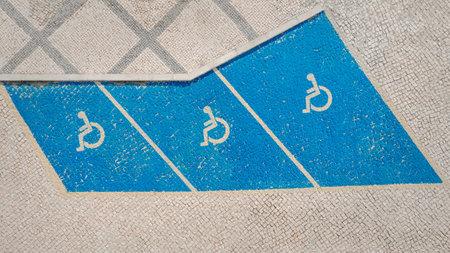 Handicap symbol on parking space. Disability car parking sign. Handicapped parking area. High quality photo Stockfoto