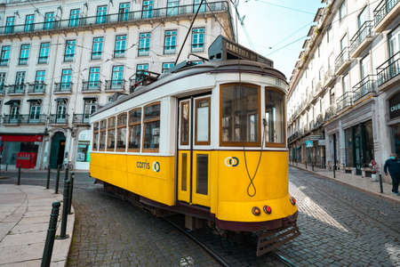 Trams in Lisbon. Tourist attraction. A famous yellow tram in old town of Lisbon, Portugal. 10.03.2020