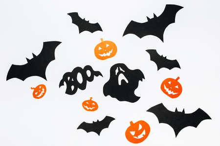 Happy halloween holiday concept. Bats, pumpkins and ghosts on white isolated background