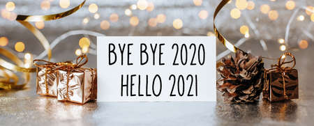 Merry christmas and merry new year concept with gift boxes and greeting card with text Bye bye 2020 Hello 2021